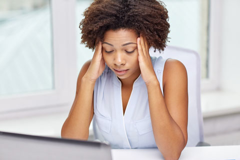Women holding head with stress tension